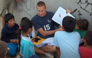 Photo of a man reading to children in Mexico